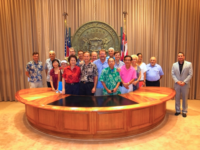 Rep's McDermott and Ward pose with members of the Waikiki Rotary in the Governors ceremonial office.